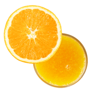 A sliced navel orange with a juice glass