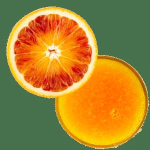 Eine aufgeschnittene Tarocco-orange mit Saftglas